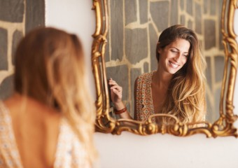 woman-reflection-self-esteem-image-mirror-stocksy-main